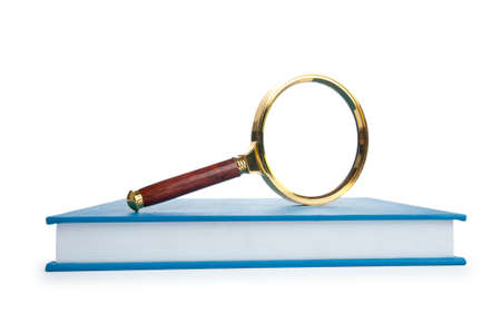 Magnifying glass over the stack of books  photo