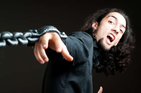 Man with metal chain around him Stock Photo - 9822896