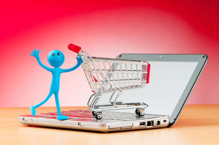 tabassum: Internet online shopping concept with computer and cart Stock Photo