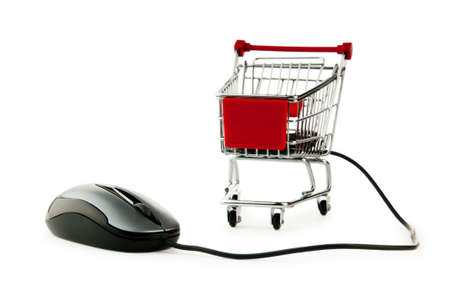 Internet online shopping concept with computer and cart Stock Photo - 9847329