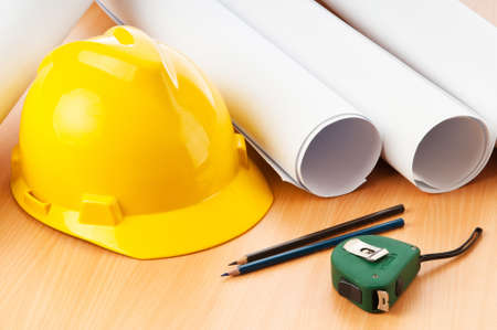 Drawings and hard hat on the desk Stock Photo - 9847609