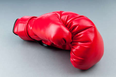 Red boxing gloves on the background photo