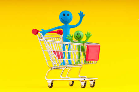 Happy family with shopping cart photo