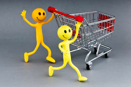 Happy family with shopping cart Stock Photo - 9847518