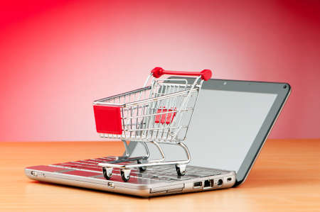 web store: Internet online shopping concept with computer and cart Stock Photo