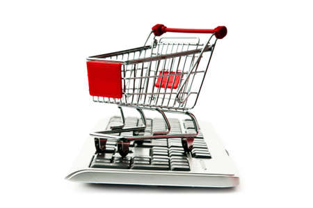 Internet online shopping concept with computer and cart Stock Photo - 9917349