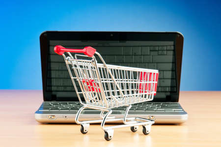 Internet online shopping concept with computer and cart Stock Photo - 9917865