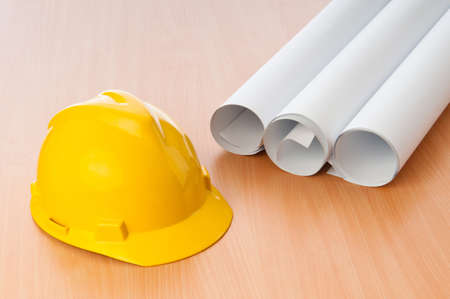 Drawings and hard hat on the desk Stock Photo - 9917998