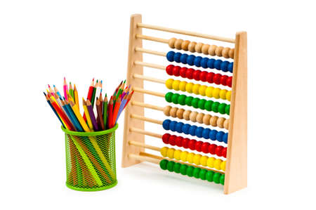 Abacus and pencils isolated on white photo