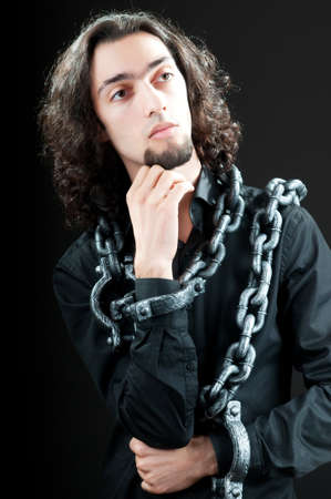 Man with metal chain around him photo