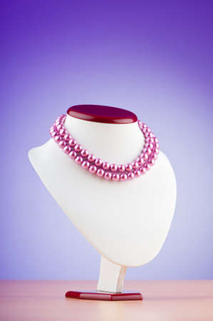 Pearl necklace against gradient background photo