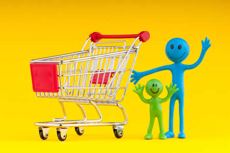 Happy family with shopping cart Stock Photo - 9917127