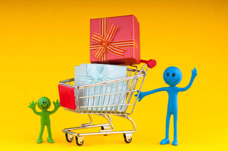 tabassum: Smileys with gift box in the shopping cart