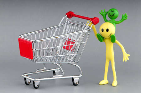 Happy family with shopping cart Stock Photo - 9917055