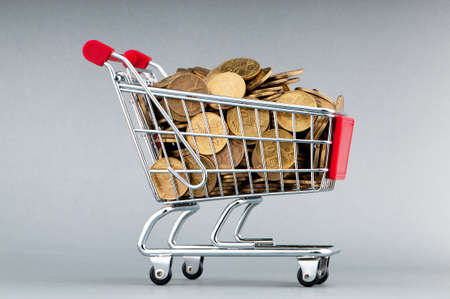 Shopping cart full of coins Stock Photo - 9917552