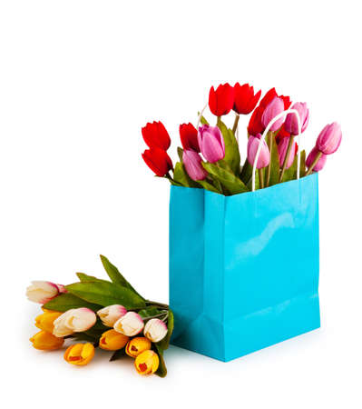 Tulips in the bag isolated on white photo