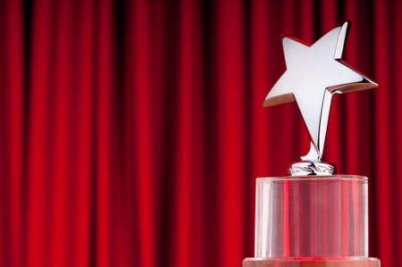 awards ceremony: Star award against curtain background Stock Photo