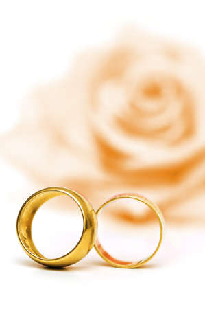 Wedding concept with roses and rings photo