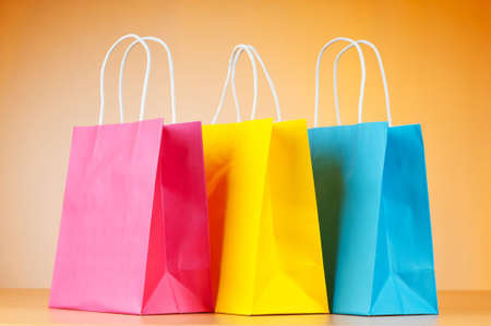 gift packs: Shopping bags against gradient background Stock Photo