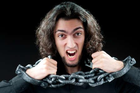 Man with metal chain around him photo