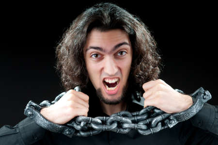Man with metal chain around him Stock Photo - 10068798