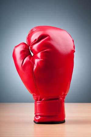 boxing equipment: Red boxing gloves on the background