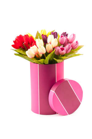 Giftbox and tulips isolated on white Stock Photo - 10058184