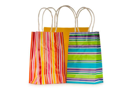 Colourful paper shopping bags isolated on white photo