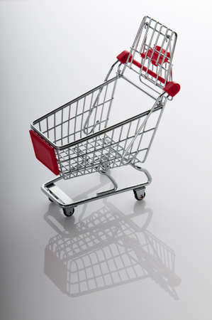 Shopping cart against the  background photo