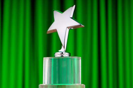 Star award against curtain background Stock Photo