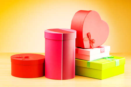 Giftboxes against gradient background Stock Photo - 10132118
