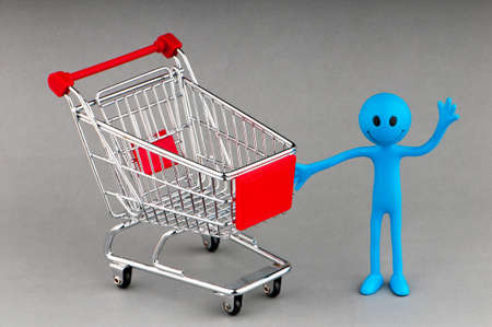 Happy family with shopping cart Stock Photo - 10131656