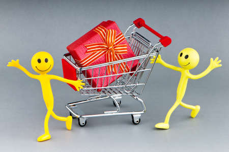 Smileys with gift box in the shopping cart photo