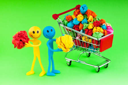 tabassum: Recylcing concept with color paper and shopping cart Stock Photo