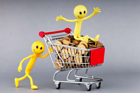 Happy family with shopping cart Stock Photo - 10131709
