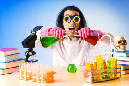 chemist's: Chemist in the lab experimenting with solutions Stock Photo