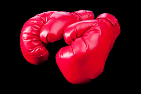 Red boxing gloves isolated on black photo