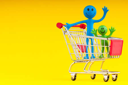 Happy family with shopping cart Stock Photo - 10289265