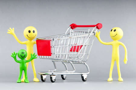 Happy family with shopping cart Stock Photo - 10289427