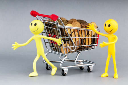 Happy family with shopping cart Stock Photo - 10289093