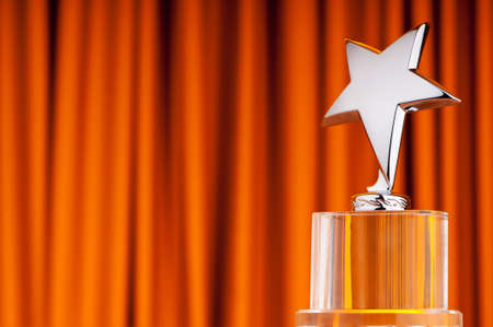 star award: Star award against curtain background Stock Photo
