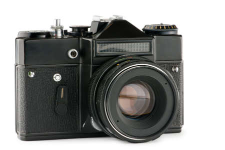 Vintage film camera isolated on white photo