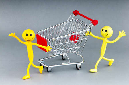 Happy family with shopping cart Stock Photo - 10306643