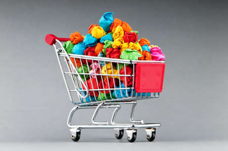 dispose: Recylcing concept with color paper and shopping cart Stock Photo