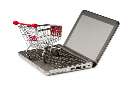 Internet online shopping concept with computer and cart Stock Photo - 10370782
