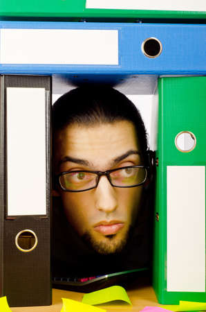Businessman with many folders on white Stock Photo - 10384438