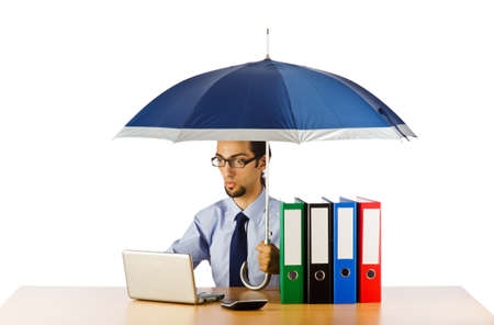 Businessman holding umbrella in the office photo