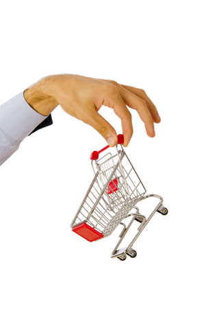 grocery trade: Hand holding shopping cart on white