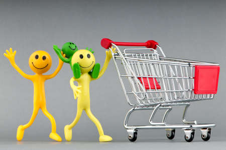 Happy family with shopping cart Stock Photo - 10371180
