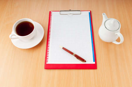 Binder with blank page and tea photo